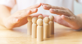 Image of Human hands over pegs on table