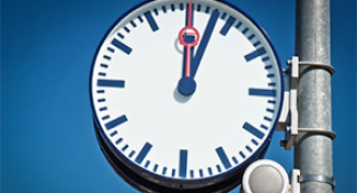 Image of An outdoor clock reading 12.05.