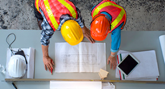 Image of Workmen looking over building plans