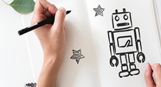 Image of Hand drawing a robot